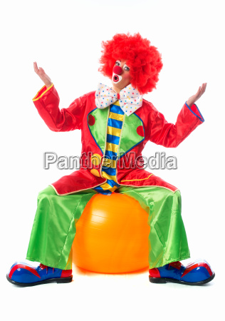clown sitting on exercise ball