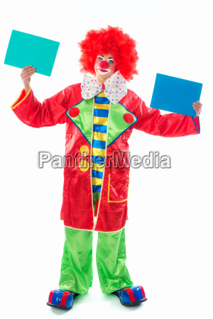 clown holds cardboard cards