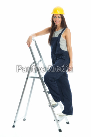 female craftsman on step ladder