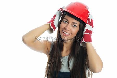 female artisan with construction helmet