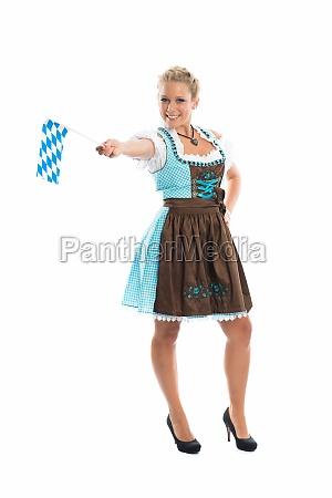 bavarian girl waving flags