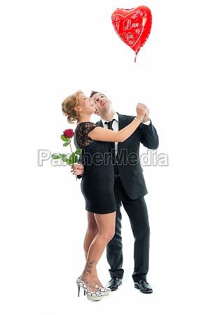 amorous couple with heart balloon