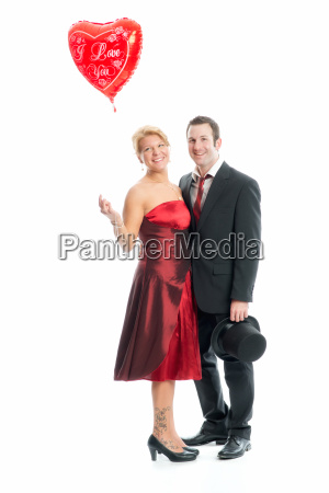couple in love with heart balloon
