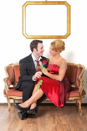 amorous couple on the sofa