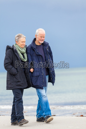 older adult happy couple walking on