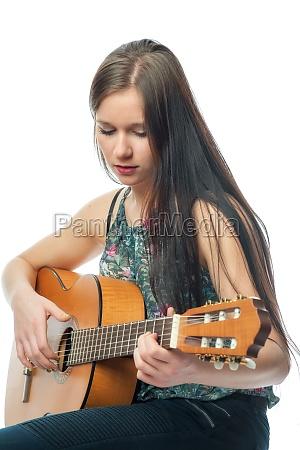 junges maedchen mit gitarre
