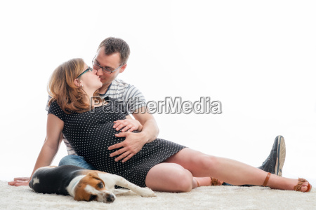 expectant parents with dog