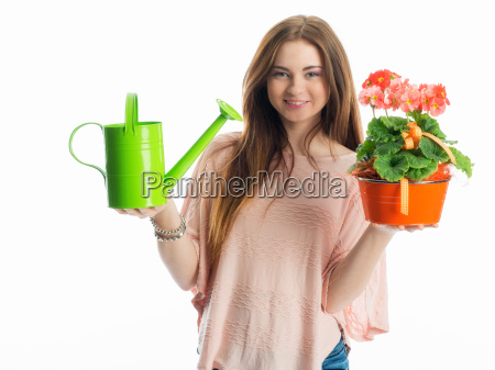 girl with potted plant and watering