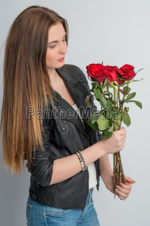 young girl holding a bouquet of
