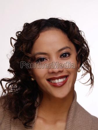 young smilinig filipino hispanic woman portrait