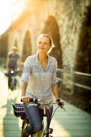 pretty young woman riding a bicycle