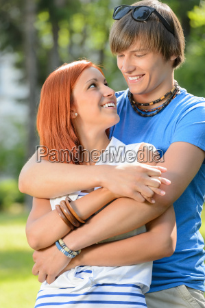 romantic couple hugging looking at each