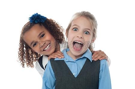 joyous school girls playing