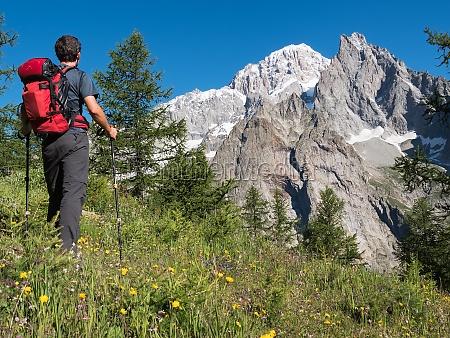 hiker admiring mountain landscape