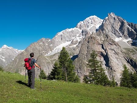 hiker admiring mountain landscape around mont