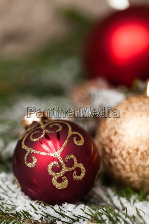 covered red christmas balls between cones