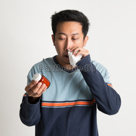 asian male sneezing
