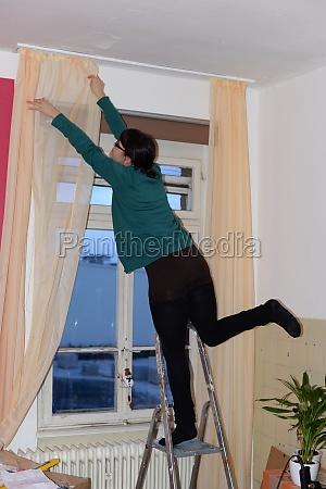woman danger household risk hazardous window