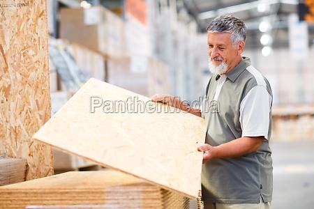 man choosing and buying construction wood