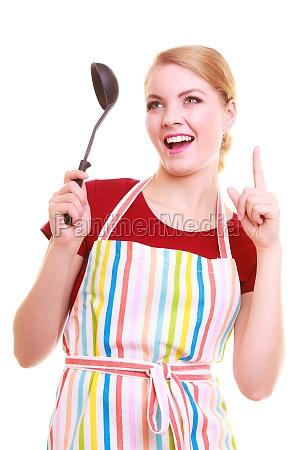 lustige hausfrau kochen oder mit schoepfloeffel