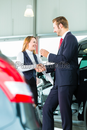 seller and customer with new cars