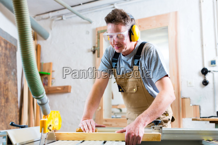 carpenter or carpenter when sawing in