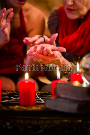 soothsayer during session doing palmistry