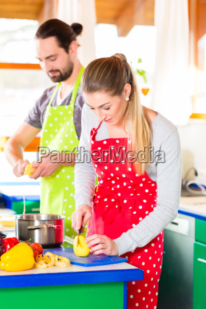 couple cooking in kitchen healthy food