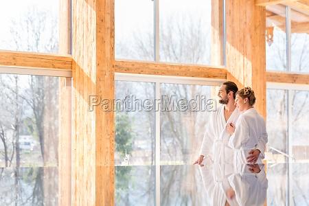 couple enjoying view in wellness spa