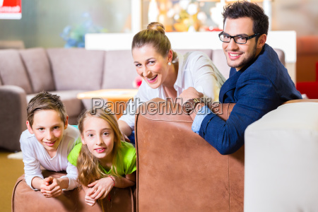 family buys coffee in furniture business