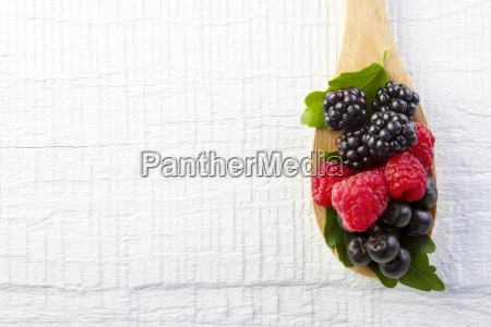 forest berries in wooden spoon