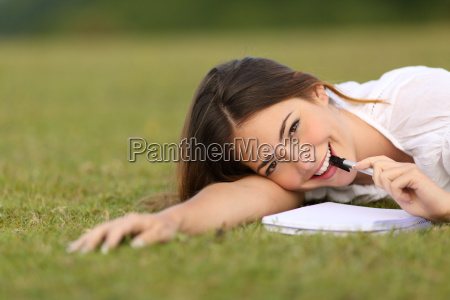 candid happy woman lying on the
