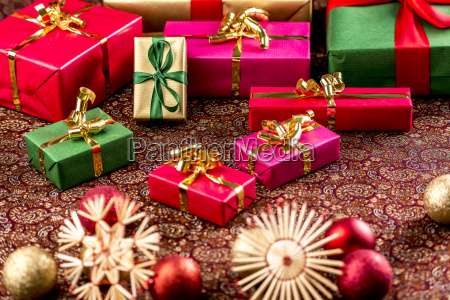 christmas gifts on richly textured cloth
