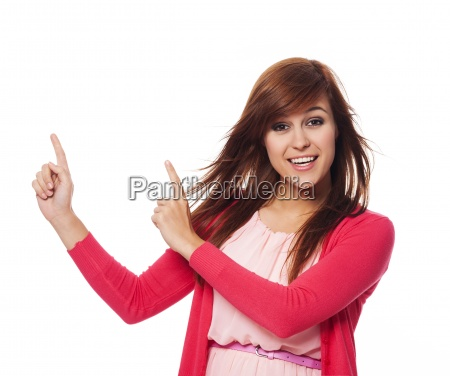 beautiful, woman, in, pink, pointing, at - 12109676