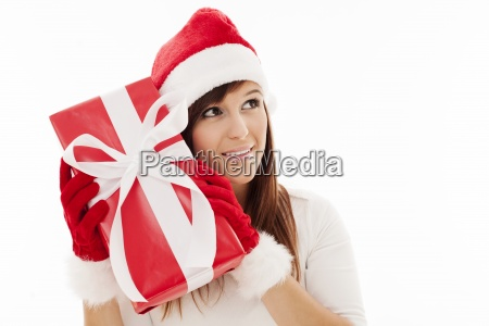 beautiful woman shaking christmas present
