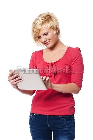 focused woman using digital tablet