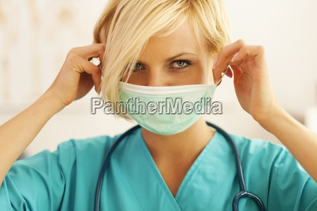 close, up, of, female, surgeon, wearing - 12112376