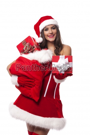 sexy woman giving christmas gifts from