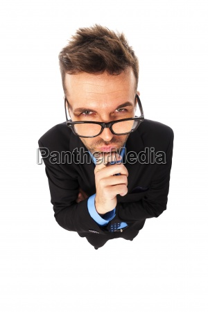 angry businessman wearing fashion glasses grimacing