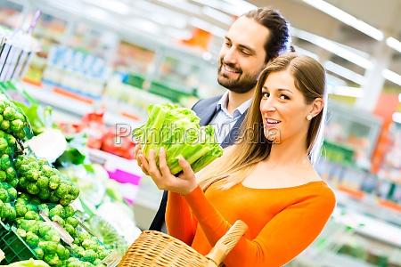 woman chooses vegetables in the food