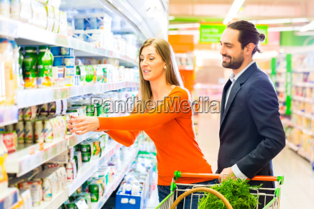 couple with shopping cart in the