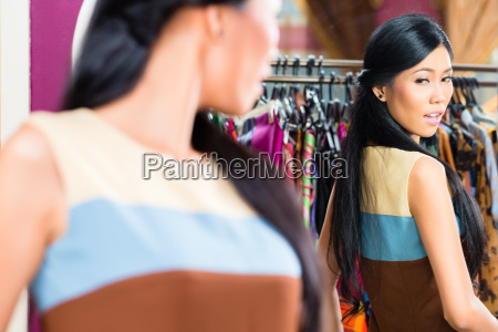 asian woman shopping in fashion store