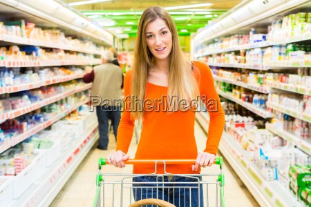woman with shopping cart in the