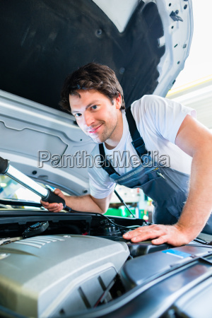 car mechanic working with tools in