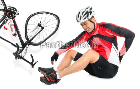 asian biker fell down from bike