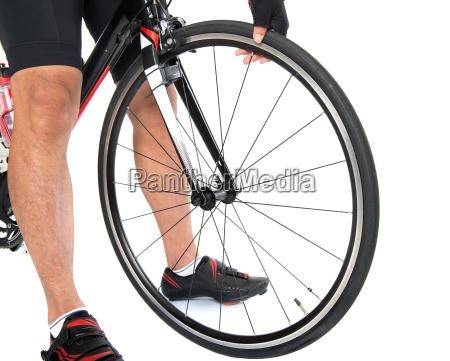 checking on bike tyre air pressure