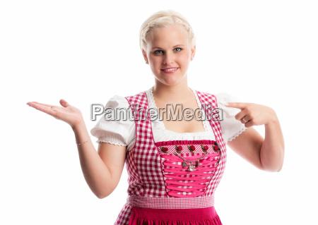 bavarian girl points with her finger