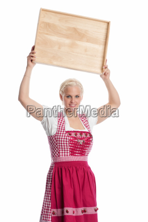 girl in dirndl holding tray