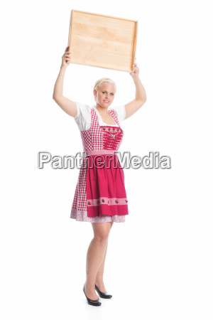 girl in dirndl holds tray