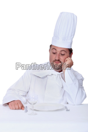 chef looking disdainfully at an empty